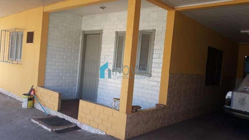 Casa 3 dormitórios no bairro Guajuviras em Canoas
